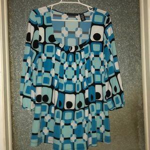 Apostrophe blouse with geometric design